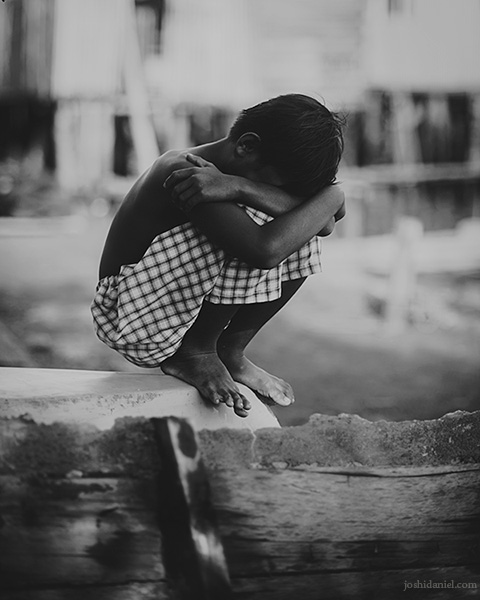 Black and white photograph of a shy boy from Senggarang Village, Indonesia